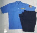 Bộ bảo vệ màu xanh đậm có bo tay ngắn